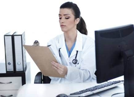 healthcare nurse doctor at computer desk