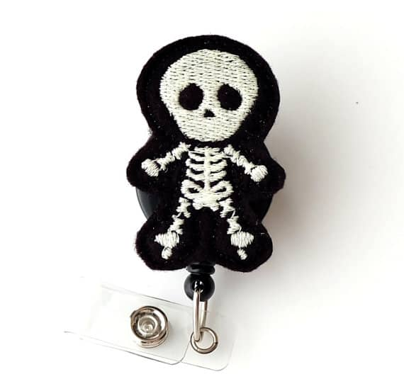 Skully Skeleton Glow In The Dark Badge Reel