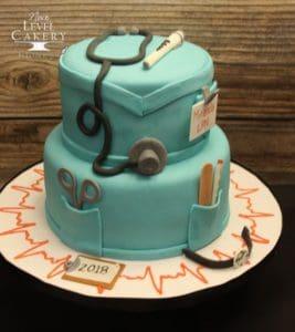 Blue nurse-themed cake