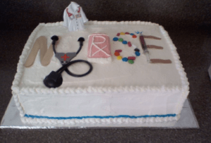 A nurse themed sheet cake with white icing