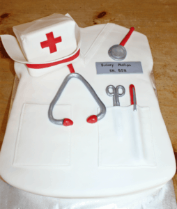 A cake designed to look like white nurse scrubs