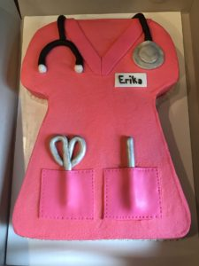 a pink scrub shaped nursing cake