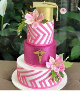 Pink and gold 3-tiered nurse cake with floral accents