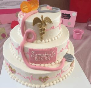 A pretty pink and white nurse cake with 3 tiers